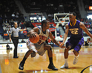 "Ole Miss' Jarvis Summers (32) vs. Lipscomb's J.C. Hampton (22) at the CM. ""Tad"" Smith Coliseum in Oxford, Miss. on Friday, November 23, 2012."