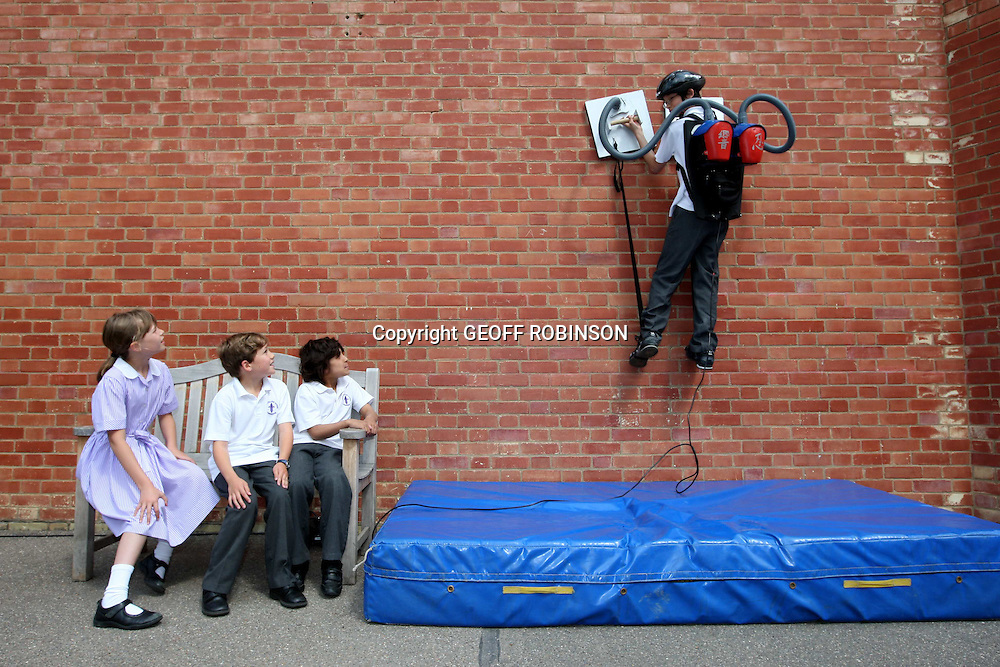 "A boy has fulfilled his dream of being Spiderman by creating a gadget to help him scale the walls of his school...Hibiki Kono, 13, (PICTURED) who is a big fan of the superhero, made the incredible climbing machine using the suction from two Tesco Value vacuum cleaners...The schoolboy then amazed his friends by using the giant suckerpads to climb the school wall during morning assembly...""I used to dress up as Spiderman when I was younger and I love all the films so it's great to be able to climb walls like him,"" said Hibiki...Hibiki spent five months designing and making the gadget in his design technology lessons at King's College School in Cambridge...He used two 1400 watt vacuum cleaners, bought for just £14.98 each from Tesco and attached square wooden pads to the nozzles...When he presses the suction pads on the wall they support his weight and enable him to climb just like his favourite superhero...SEE COPY CATCHLINE Boy becomes spiderman."