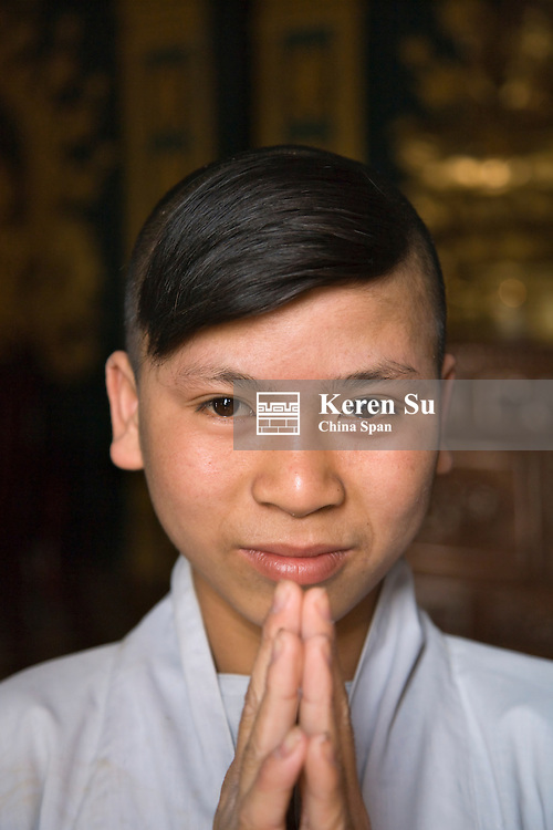 Novice monk in Chinese temple.