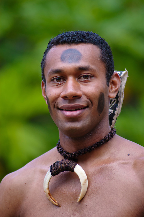 Fijian man Vito Qaqa, from Vitu Levi, Fiji, in traditional warrior outfit, at Polynesian Cultural Center, Oahu, Hawaii.