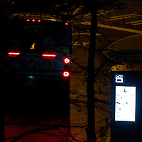 A high-tech kiosk lets riders know when the next bus is coming and where it is headed too - need a ride?