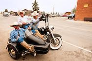 Wilsall Ranch Rodeo, Montana, cowboys, Lee Pinkerton, Jason O'Hair, Mike Block, having fun on motorcycle after rodeo