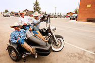 Wilsall Ranch Rodeo, Montana, cowboys, Lee Pinkerton, Jason O'Hair, Mike Block, having fun on motorcycle after rodeo