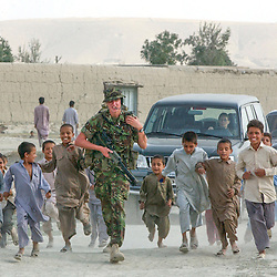 British International Security Forces patrol through a neighborhood of Kabul, Afghanistan  August 7, 2002 .    (photo by Ami Vitale)