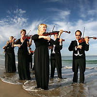 "3-NEWS FEATURE.Paul Kane (Getty Images).Musicians from the West Australian Symphony Orchestra perform a ""Symphony in the Sea"" at North Cottesloe Beach."