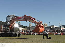 "A dance duet between man and machine is the simplest way to describe the breathtaking outdoor performance of Transports Exceptionnels. Transcending spectacle and danger, dancer Philippe Priasso is paired with a mechanical digger in this astoundingly witty exploration of the traditional ""dance for two""...Performed to the dramatic voice of Maria Callas, Transports Exceptionnels follows an intimate seduction initiated by Priasso. Flesh meets iron in a tender give and take, and the digger's innermost sensitivity is revealed - rendering her almost human. Nothing will prepare you for the surprise of this emotional romance, which is both industrial and poetic."