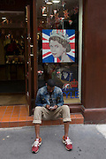 Young man sits outside the Gola sports shoe shop in Carnaby Street in the week of the Queen's diamond Jubilee celebrations.
