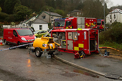© Licensed to London News Pictures. 22/12/2012. Helston, UK. Specialist pumping equipment being used to prevent flooding of properties around St Johns Road in Helston. The River Cober burst its banks over night after heavy rain across the South West. The Environment Agency issued a Severe flood warning for the River Cober. Photo credit : Ashley Hugo/LNP