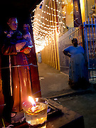 Decorated alleyway on Ratnam Road. Lights beside a Hindu temple for the feast of St. Anthony. June 2012