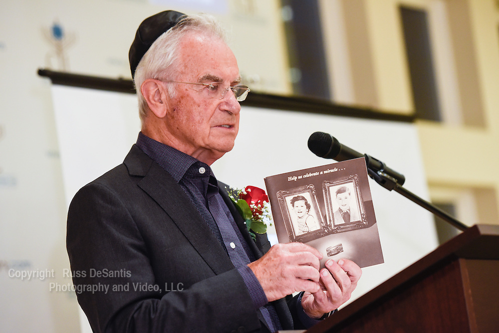 Holocaust survivor Michael Kaplan, Highland Park, speaks during the ceremony. The Center of Jewish Life in Marlboro, NJ, held a ceremony to mark Holocaust Remembrance Day on Thursday, April 16,2015. /Russ DeSantis/Special to the Asbury Park Press / SLUG-asb 0417 holocaust remembrance