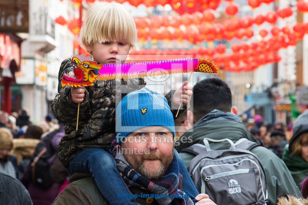 Eric, 4 , his paper dragon and his dad Freddie from Sweden, along with Thousands of Londoners help the capital&rsquo;s Chinese population celebrate their new year, The Year of The Monkey in Chinatown, London.<br /> Picture by Paul Davey/Focus Images Ltd +447966 016296<br /> 14/02/2016