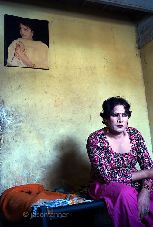 The word Hijra is an Urdu word meaning eunuch or hermaphrodite. However, most Hijras in Pakistan are gay men who leave home to join the Hijra community as young boys where there is more acceptance. Most identify themselves as more feminine then masculine and dress and act accordingly...Although tolerated in a country where homosexuality is against the law, Hijras are largely ostracised from society. They are often denied work opportunities, rejected by most families, lack formal education and live in poorer areas of the city...They share similarities with the more famous Hijra communities in the Indian subcontinent and Bangladesh. In a continent where great emphasis is placed on one's ability to have children, those who are unfortunate not to be able to conceive children are not considered a true man or woman. Life for many Hijras in Pakistan consists of begging for alms (Zakat) in the more prosperous areas of the city as well as slums in addition to receiving alms when bestowing blessings on male babies and at weddings....Most Hijras dress as women, and engage in activities such as dancing and entertaining in public - activities that would be considered inappropriate for women of the subcontinent. Some members of the community engage in prostitution. .