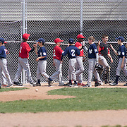 04/14/12 Newark Del. Yankees and Angels players meet at home plate after a Angels 9-0 Canal L.L. League victory over the Yankees Saturday, April. 14, 2012 at Canal L.L. Complex in Bear Delaware...Special to The News Journal/SAQUAN STIMPSON