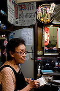 """Toshiko Yoshizawa (87) has a little restaurant called """"Aizu"""" on Nonbei street. Nonbei street in Shibuya is a narrow street with little restaurants and bars, each one with a special character. Tokyo 16 September 2008, Japan"""