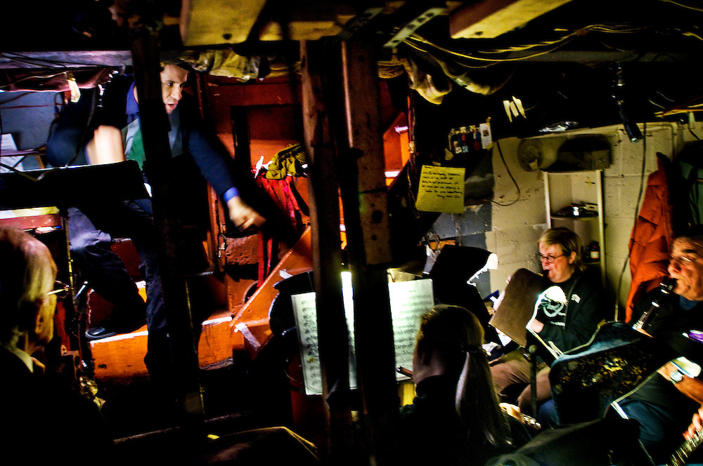 Amato Opera <br /> <br /> The conductor has to bend down in order to see the musicians located under the stage.<br /> <br /> The Amato Opera company was founded by husband and wife Tony and Sally Amato in 1948. <br /> <br /> The opera house is located on The Bowery, in New York's East Village,  next door to where the legendary punk rock club CBGB used to be.<br /> <br /> While Tony acted as artistic director, selecting the productions, auditioning and casting, rehearsing and training the cast and conducting most of the performances, his wife Sally functioned as seamstress, light board operator, cook, box office manager, publicist, business manager, and, as Serafina Bellantoni, singer for the company until her death in 2000.<br /> <br /> Today Tony at the age of 88 is still running the company like he promised his wife he would, and the Amato Opera maintains its goals of providing opera at a reasonable price and giving promising singers stage experience in full-lenght productions.<br /> <br /> Photographer: Chris Maluszynski /MOMENT