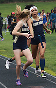 Ariana Taylor drops the baton as she hands off to Kamryn Osterbind in the 4x400 at the Ohio Capital Conference-Ohio Division track meet Saturday. .