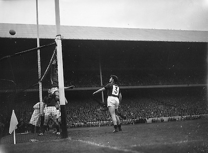 All Ireland Senior Football Championship Final, Kerry v Down, 25.09.1960, 09.25.1960, 25th September 1960, Down 2-10 Kerry 0-8,..Down goalie E McKay jumps and Down Full back L Murphy (no 3) watches as the ball goes over the bar for one of Kerry's second half points, ..Referee J Dowling (Offaly),.Captain K Mussen,.