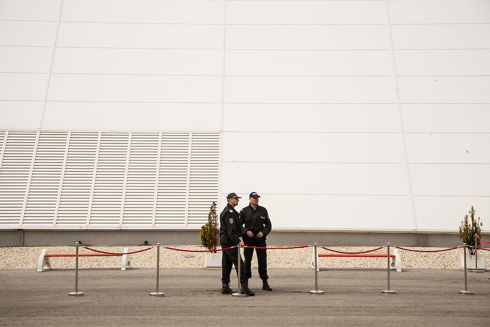 Police wait outside of the immigration terminal in the Burgas Port in Bulgaria. The Prime Minister of Bulgaria, Boyko Borissov, was visiting the port for a military/immigration exercise.<br /> <br /> Matt Lutton / Boreal Collective for VICE