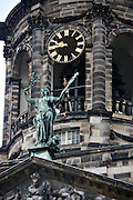 Clock on the Royal Palace Dam Square in Amsterdam.