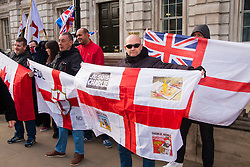 """London, February 8th 2015. Muslims demonstrate outside Downing Street  """"to denounce the uncivilised expressionists reprinting of the cartoon image of the Holy Prophet Muhammad"""". PICTURED: A handful of counter-protesters from the English Defence league gather opposite the main site of the protest on Richmond Terrace."""