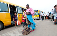 MWANZA, TANZANIA.  Passengers exit shuttle buses after arriving on an African carrier Fastjet Airbus aircraft at Mwanza Airport in Mwanza, Tanzania on Tuesday, September 2, 2014.  © Chet Gordon/THE IMAGE WORKS