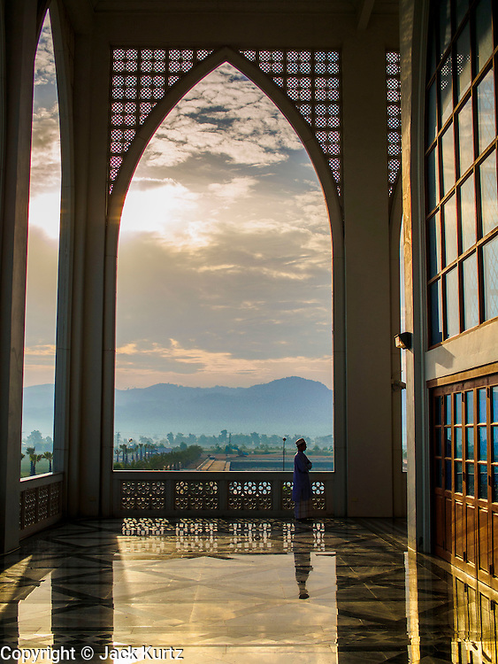 A man waits for Eid services to start at Songkhla Central Mosque. Eid al-Fitr is also called Feast of Breaking the Fast, the Sugar Feast, Bayram (Bajram), the Sweet Festival and the Lesser Eid, is an important Muslim holiday that marks the end of Ramadan, the Islamic holy month of fasting.