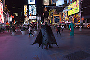 batman walking through Times Square at night in New York City