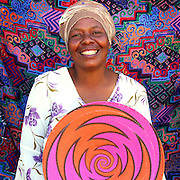 Artist Zeni Sabeth Masina weaves telephone wire bowls.
