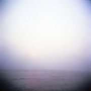 "One early morning offshore Rhode Island, as the sun peaks through the fog.  I was shooting with film and was equipped with the cult classic medium format plastic ""toy"" Holga camera.  Stripped of over complicated controls, this camera just allows you to focus on composition and snap away."