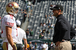 Sept 30, 2012; East Rutherford, NJ, USA; San Francisco 49ers quarterback Alex Smith (11) and San Francisco 49ers head coach Jim Harbaugh talk before the game between the New York Jets and the San Francisco 49ers at MetLIfe Stadium.