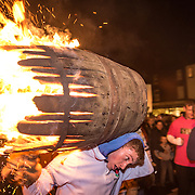 The barrel soon burns down as its paraded shoulder high through the narrow streets.