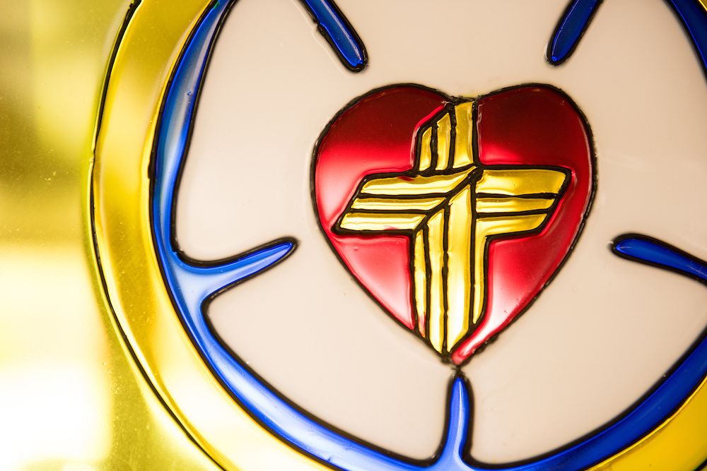 A stained glass artwork of the LCMS cross hangs Sunday, Nov. 22, 2015, at Salem Lutheran Church in Springdale, Ark. LCMS Communications/Erik M. Lunsford
