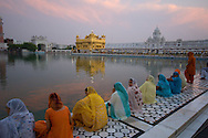 One of the most beautiful places in all the world has to be The Golden Temple in Amrtisar, India. It's the most important temple of the Sikh religion, and an incredible place of peace and beauty. Sikh pilgrims come from all over the world to meditate here and are welcomed by open arms and incredible kindness. The site has a free dormitory (even for western visitors) and the cafeteria serves 20,000 free meals a day.