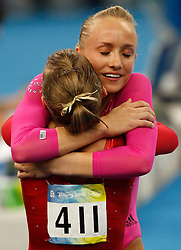 USA's Nastia Liukin hugs compatriot Shawn John after winning the gold for artistic gymnastics women's individual all-around finals during the Olympic games in Beijing, China, 14 August 2008. Liukin won the gold medal for the event with compatriot Johnson and China's Yang Yilin taking silver and bronze respectively.