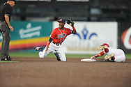 Mississippi's Will Allen (30) scores as Louisiana-Lafayette's Ryan Wilson (23) backs up the play in an NCAA Super Regional game in Lafayette, La. on Sunday, June 8, 2014. Mississippi won 5-2.