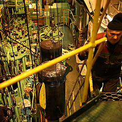 The engine room of the Alfa K, a Mediterranean based bulk carrier with a Panamanian flag, undergoes maintenance repairs at the port of Piraeus in Greece on Feb. 20, 2008. Inspectors impose ITF-standard treaties on ship-owners to guarantee minimal standard working conditions for seafarers. They are on call 24 hours a day to address concerns from workers coming to port on the international ships.