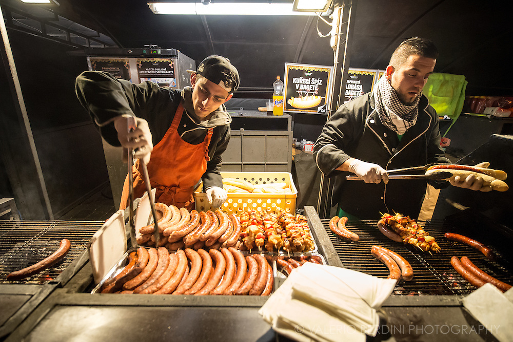 Grilled sausages and skewers are traditional street food found in Prague markets.