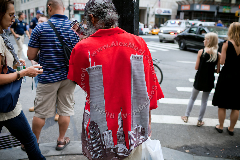 An image of the twin towers is printed on a shirt of man walking on the street in Lower Manhattan, New York, USA, on the 10th anniversary of the 9/11 attacks on the Word Trade Centre.