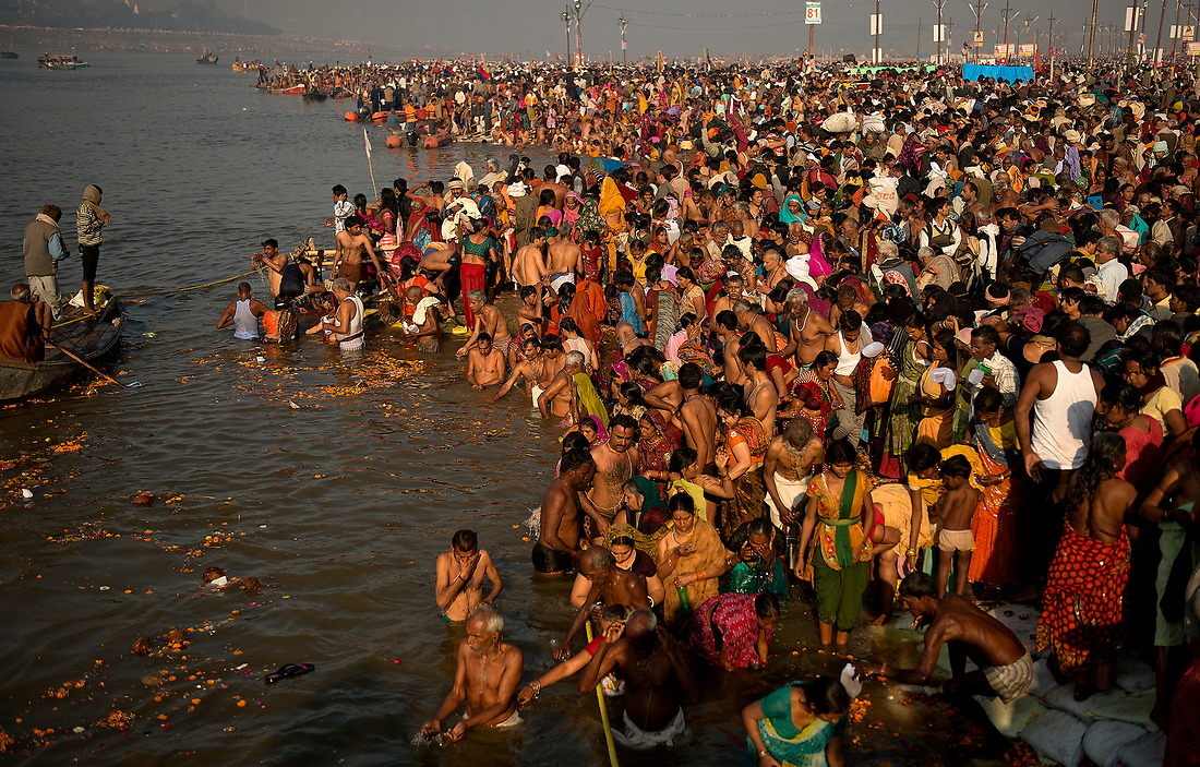 Hindu pilgrims take turns bathing on the main bathing day on February 10, 2013 in Allahabad, India during the Kumbh Mela. This main bathing day observes the largest gathering of people in a single day because it is a believed that by bathing on this day a person can acquire good karma which thereby helps pursuing a fruitful and religious life. — © Jeremy Lock/