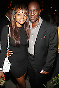 l to r: Keesha Johnson and Len Burnett at Uptown Magazine's 5th Anniversary Party held at The Maritime Hotel on September 22, 2009 in New York City