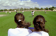 Two girls training wearing horse-tail haircut.