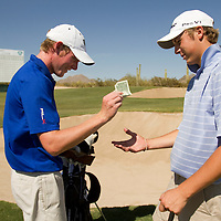 American Junior Golf Association player Grayson Murray, left, pays a buck on a friendly wager to Jordan Spieth at the Thunderbird International Junior tournament.