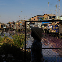 Slum housing over a heavily polluted and stagnant water in the south of the city.