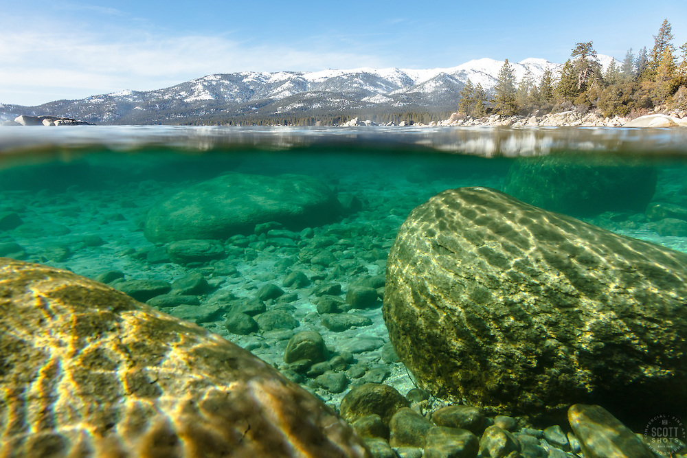 """Boulders Under Lake Tahoe 1"" - Over/Under photograph of boulders under the surface of Lake Tahoe."