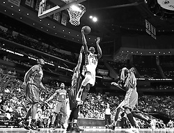 Apr 11; Newark, NJ, USA; New Jersey Nets guard Ben Uzoh (18) hits a layup during the first half at the Prudential Center.