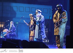 Born out of Libyas refugee camps and refined during Malis Tuareg revolutions, Tinariwens music began as a way to highlight the persecution of their nomadic people. Their hypnotic brand of desert blues, based on traditional West African rhythms, features incredible electric guitar riffs and the vibrant beats of hand drums. Their lyrics rage against the indifference to their plight and express nostalgia for a lifestyle that has existed for thousands of years, but is fast disappearing...In a career that has now spanned 30 years, Tinariwen has produced five albums (their last recorded on acoustic instruments in the desert) and played over 700 major festival concerts throughout the world, inspiring everyone from Carlos Santana to Coldplays Chris Martin along the way. From the sands of the Sahara to the Town Hall stage, you have to be there for this extraordinary group.