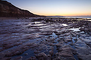 Dawn breaking over the Wealden Marl Beds which form Brook Ledge on the Isle of Wight. These rocks,