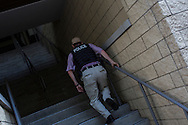 A police officer runs up a flight of stairs on Monday, September 3, 2012 in Charlotte, NC.