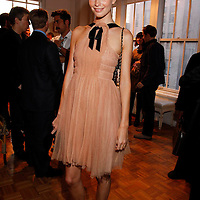 """Poppy Delavigne attends the opening of """"Lady"""" by Douglas Friedman at the Ruffian Gallery on April 23, 2009 in New York City."""