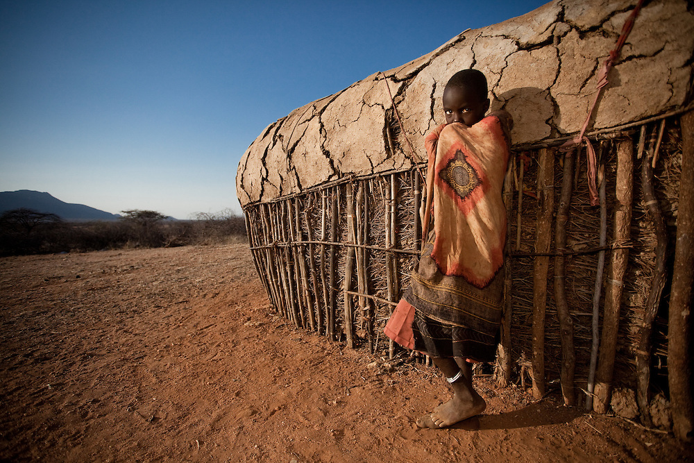 Second Place, National Geographic Traveler Photo Awards 2010. A girl stands in front of her hut in a Samburu community in northern Kenya